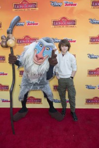 Standing next to Rafiki is the voice of Kion, Max Charles